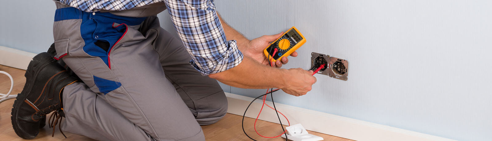 Male Electrician With Screwdriver Repairing Fire Sensor